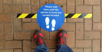 A blue sign on the ground that says