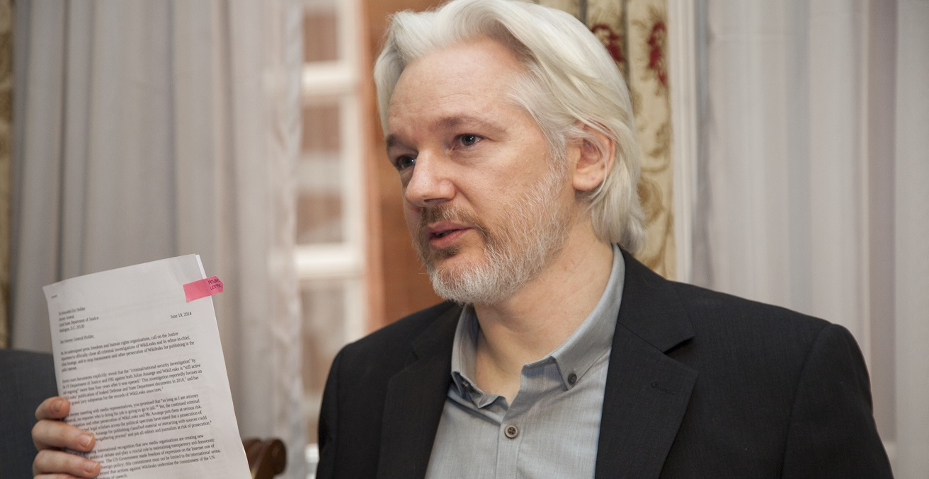 Julian Assange at a press conference at the Ecuadorian Embassy in London. Source: David G Silvers https://bit.ly/3bxnfdq