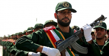 A soldier of the Iranian Revolutionary Guard Corps marches in a military parade commemorating the first day of Holy Defence Week in Qom, Iran. Source: Mohammad Ali Marizad https://bit.ly/3bbhsKn