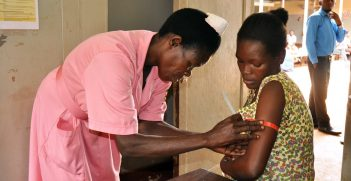 Hellen, a nurse in the ANC clinic of Jinja Regional Referral Hospital assesses the nutritional status of Proskovia, a 20 year old woman who is 3 months pregnant with her third child. Source: Kate Consavage/USAID https://bit.ly/2NPGXrL