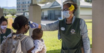 Kamala Jones administers a temperature check on a parent at the Center Drive Child Development Center on Joint Base Pearl Harbor-Hickam. Source: U.S. Navy photo by Mass Communication Specialist 2nd Class Charles Oki https://bit.ly/3cVzroY