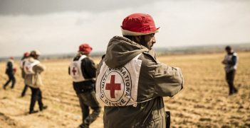 A group of farmers sow wheat seeds in the presence of ICRC staff. Photo supplied by the ICRC.
