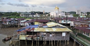 The famous Kampung Ayer, a collection of houses, shops, schools and clinics, is perched on stilts in the Brunei River. Located opposite this water village in the centre of town are speculator mosques and the world's largest royal palace. Source: Bernard Spragg https://bit.ly/30bGvtk