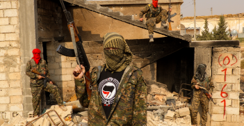 Antifascist from 0161 Antifa Manchester Crew in the International Freedom Battalion (IFB) in Rojava. Source: Wikipedia https://bit.ly/390frRK