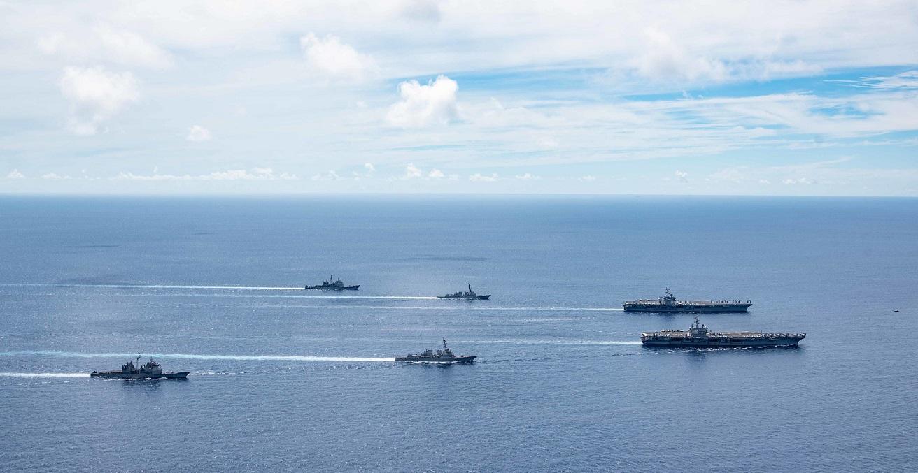 The USS Ronald Reagan (CVN 76) and USS Nimitz (CVN 68) Carrier Strike Groups (CSGs) steam in formation. Source: Petty Officer 3rd Class Jason Ta https://bit.ly/3ePbwbT