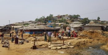Community members gather around a water point in the main Kutupalong-Balukhali camp near Cox's Bazar. Photo supplied by the ICRC.