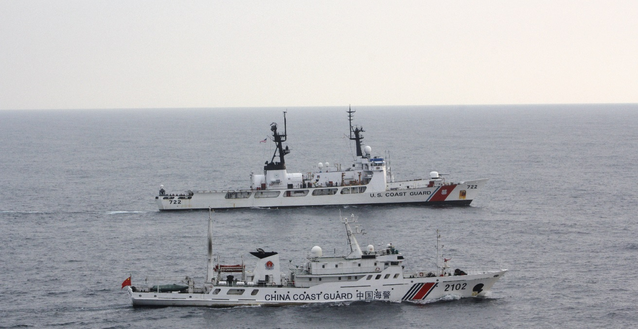 The Coast Guard Cutter Morgenthau and China coast guard vessel 2102 steam alongside each other during the transfer of the fishing vessel Yin Yuan in the North Pacific Ocean June 3, 2014. The Morgenthau crew was patrolling in support of Operation North Pacific Guard, the Coast Guard's component of a multi-lateral fisheries law enforcement operation designed to detect and deter illegal, unreported and unregulated fishing activity. Source: U.S. Coast Guard Cutter Morgenthau https://bit.ly/30UyXgo