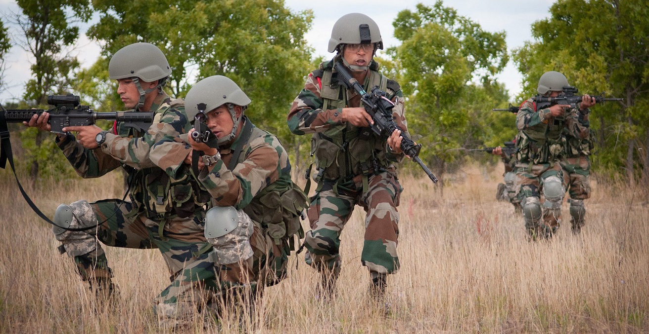 Indian Army soldiers with the 99th Mountain Brigade's 2nd Battalion, 5th Gurkha Rifles, move into position while demonstrating a platoon-level ambush. Source: US Army https://bit.ly/2XQXwcc