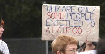 A sign from a rally in Melbourne for refugees in detention reads,