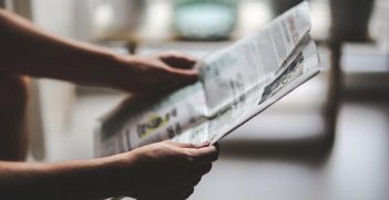 Person reading a newspaper Source: https://bit.ly/3c9uZnO