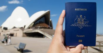 Australian passport held in front of the Sydney Opera House.  Source: Shutterstock.