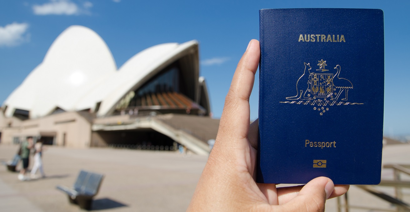 Australian passport held in front of the Sydney Opera House.  Source: Shutterstock.