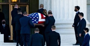 Ruth Bader Ginsburg's casket being carried into the Supreme Court, as her former law clerks line the steps. Source: Victoria Pickering, https://bit.ly/3cMtRHb