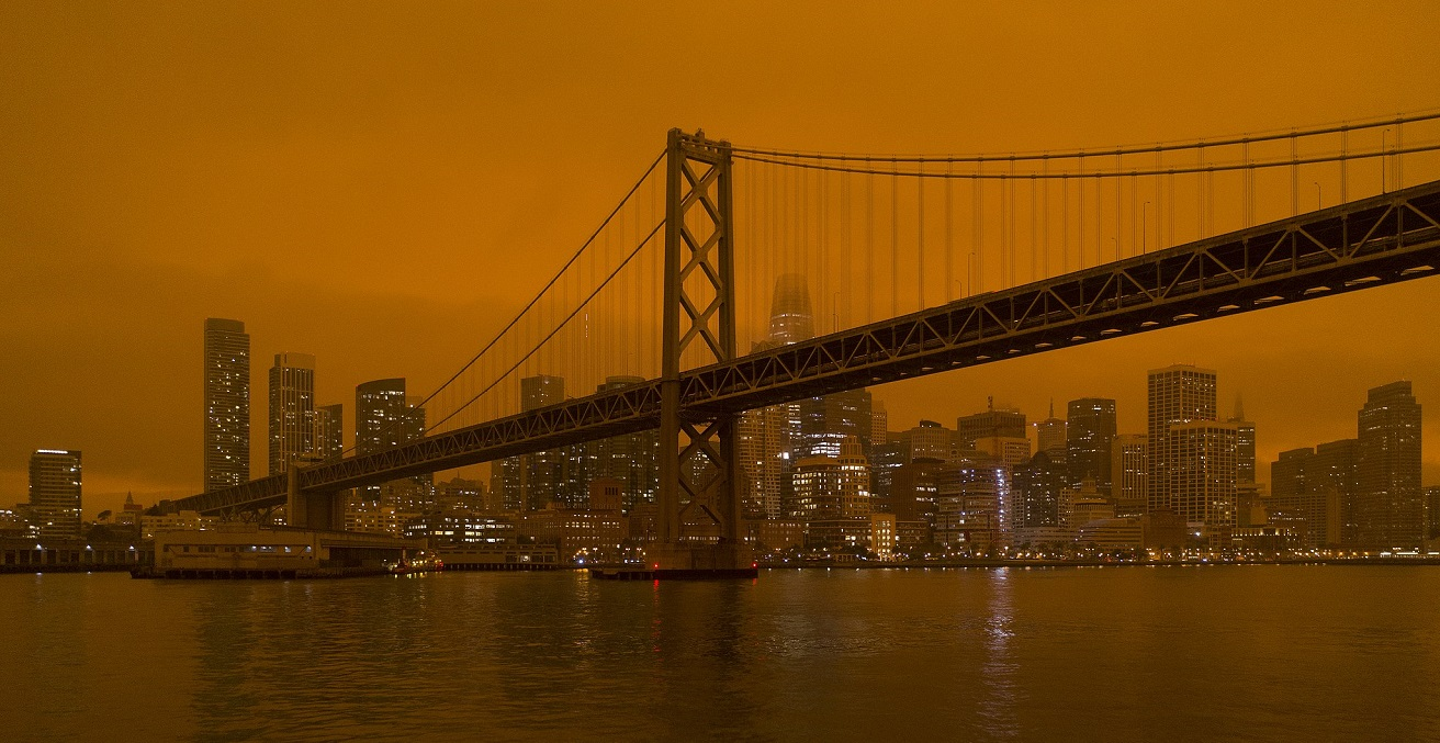 Smoke from the North Complex fire settling over San Francisco, turning the daytime sky a dark orange. Source: Christopher Michel, https://bit.ly/3d8JNnd