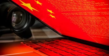 Computer screen with Chinese flag and source text.  Source: Shutterstock.
