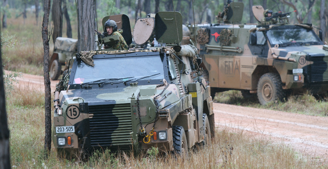 Two Bushmasters operated by the 2nd Battalion, Royal Australian Regiment during an exercise. Source: Wikimedia Commons https://bit.ly/3p1ab73