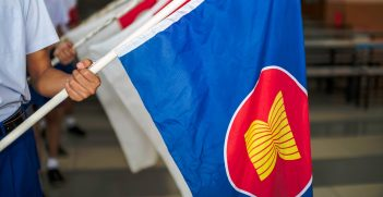 Hand holding Fabric Flags of the Association of Southeast Asian Nations. Source: BeanRibbon/Shutterstock.