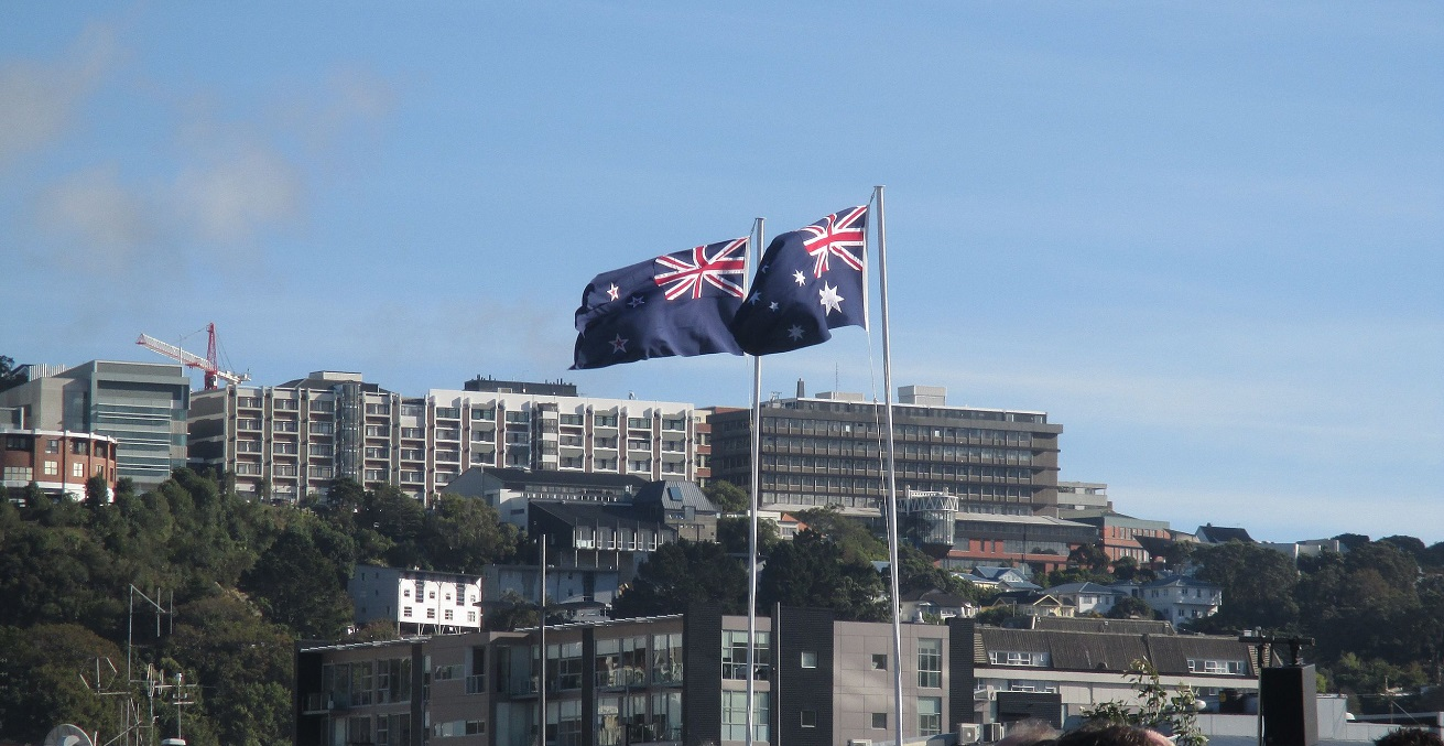 The New Zealand and Australian flags flying next to each other at the Dedication of the Australian Memorial at Pukeahu National War Memorial Park, Wellington, New Zealand. Source: Wiremu Stadtwald Demchick https://bit.ly/3zlVEZR