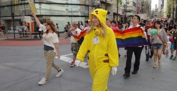 People marching, including one dressed as Pikachu, in a Tokyo Pride Parade. Source: Lauren Anderson https://bit.ly/3xb2ZKi