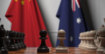 A chessboard in front of Australian and Chinese flags. Source: Shutterstock.