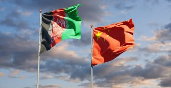 State flags of China and Afghanistan together in front of a sky background. Source: Leo Altman/Shutterstock.