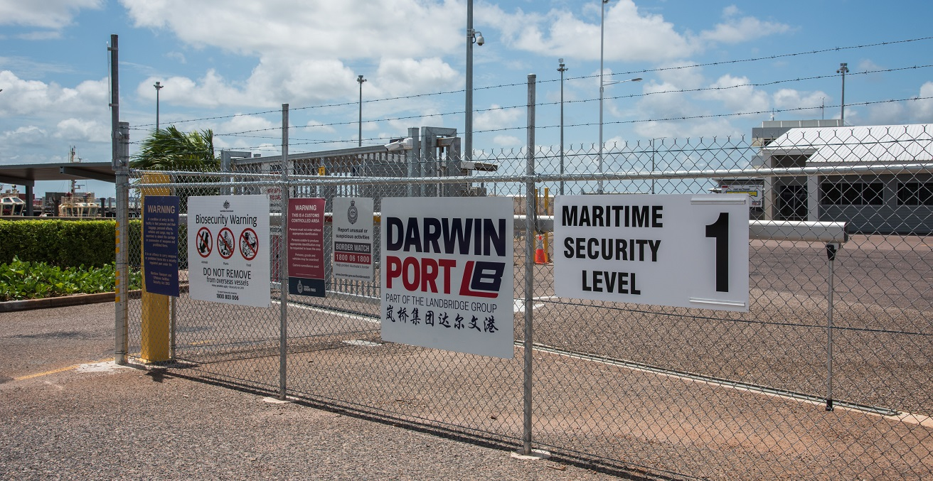 Border patrol area fence with signs at the port in the waterfront district of Darwin, Australia. Source: EA Given/Shutterstock