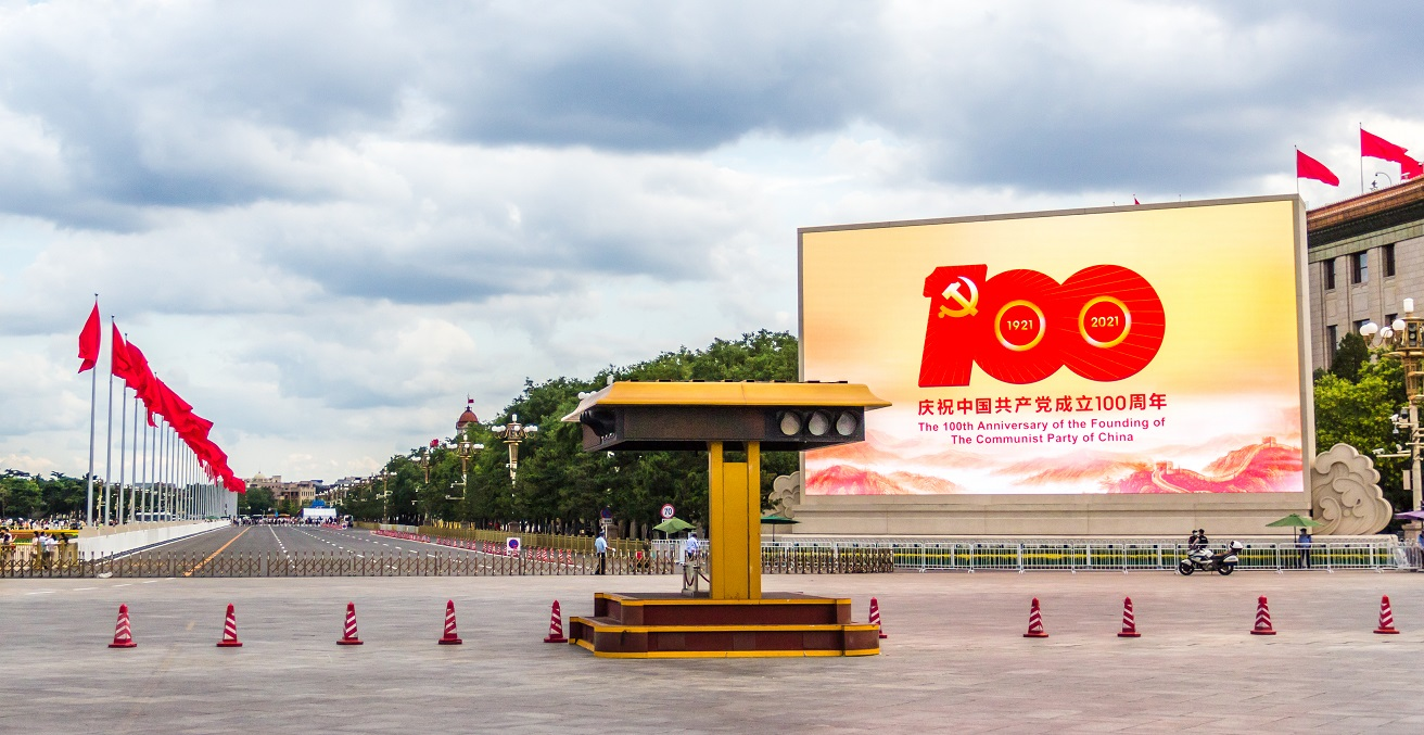 Red flags and the symbol of the 100th anniversary of the founding of the Communist Party (CCP) of China displaying on giant screen at TianAnMen Square Beijing. Source: Tarek Islam/Shutterstock.