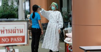 A healthcare worker takes a temperature at Thailand Bamrasnaradura Infectious Disease Institute, Ministry of Public Health. Source: UN Women/Pathumporn Thongking https://bit.ly/3CkHzNL
