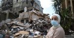 A woman in front of a destroyed house, Karantina, Beirut. Source: Dar Al Mussawir https://bit.ly/3jBweRd