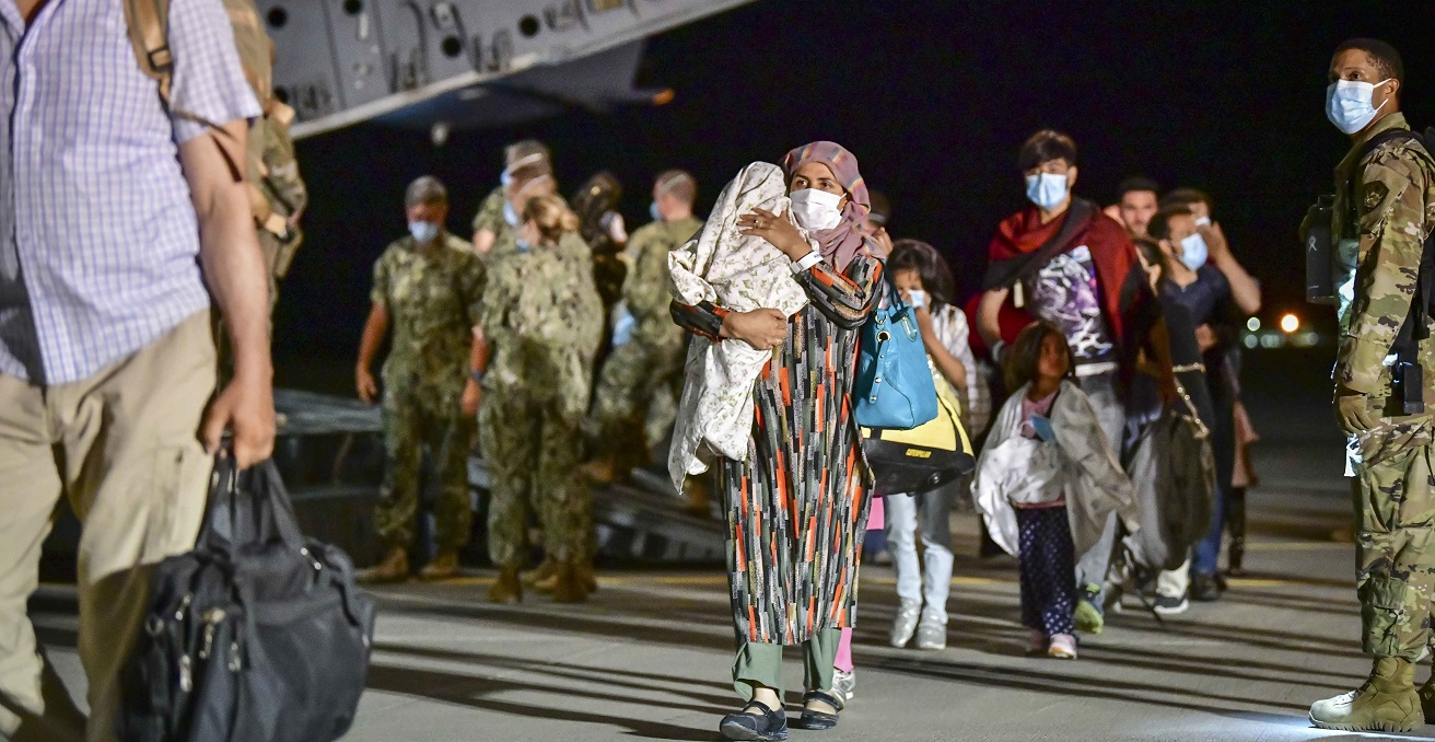 Afghan evacuees disembark a U.S. Air Force C-17 Globemaster III at Naval Air Station Sigonella, Aug. 22, 2021. NAS Sigonella is currently supporting the Department of Defense mission to facilitate the safe departure and relocation of U.S. citizens, Special Immigration Visa recipients, and vulnerable Afghan populations from Afghanistan. (U.S. Navy photo by Mass Communication Specialist 1st Class Daniel Young)