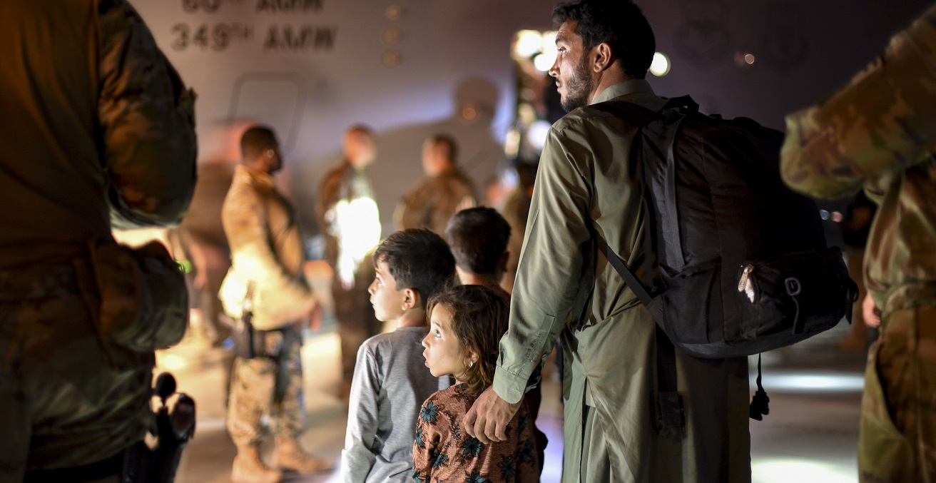Afghan father and children evacuees leave a U.S. C-17 Globemaster after arriving to Ali Al Salem Air Base, Kuwait, August 24, 2021. The Department of Defense is committed to supporting the evacuation of American citizens, Special Immigrant Visa applicants and other at-risk individuals from Afghanistan. (U.S. Air Force photo by Staff Sgt. Ryan Brooks)