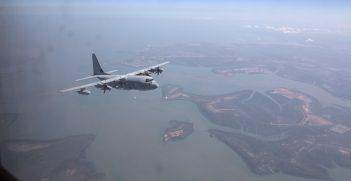 U.S. Marine Corps C-130J Super Hercules with Marine Aerial Transport Squadron (VMGR) 152 fly over Australia heading to their final destination Brisbane, Australia.  (U.S. Marine Corps photo by MCIPAC Combat Camera Cpl. Sara A. Medina/RELEASED)