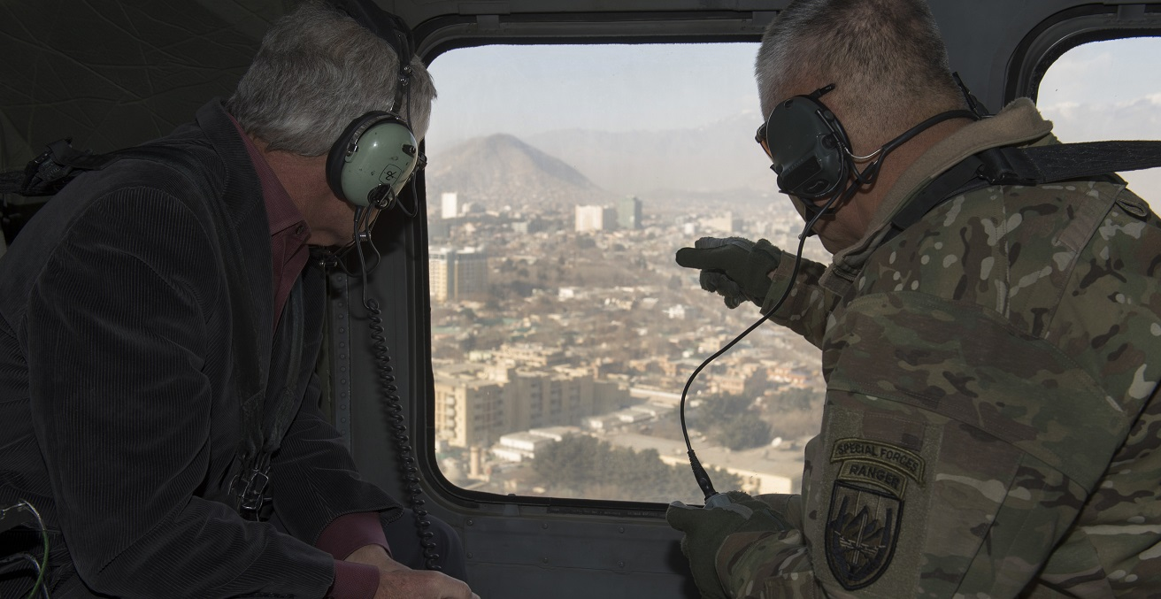 U.S. Army Gen. John F. Campbell, commander of the International Security Assistance Force and U.S. Forces-Afghanistan highlights some of the countryside to Secretary of Defense Chuck Hagel, as they fly to Forward Operating Base Gamberi to visit service members, Dec. 7, 2014. (Photo by Master Sgt. Adrian Cadiz/Released)