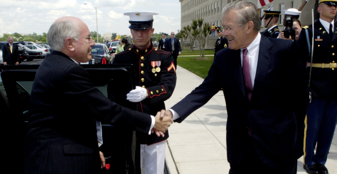 add_photo_alternate  The Honorable Donald H. Rumsfeld (right, U.S. Secretary of Defense, welcomes Australian Prime Minister John Howard to the Pentagon, Arlington, Va., on May 15, 2006. (DoD photo by PETTY Officer 1ST Class Chad J. McNeeley)