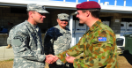 Australian Army Captain Sam Thackray presents 3RAR Parachute Wings to Command Sergeant Major Kirk Johnson as US Army Battalion Commander Lieutenant Colonel Thomas Ellis watches on.