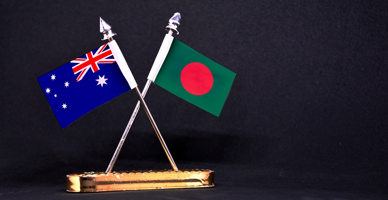 Australia and Bangladesh table flag with black Background. Source: Aritra Deb/Shutterstock