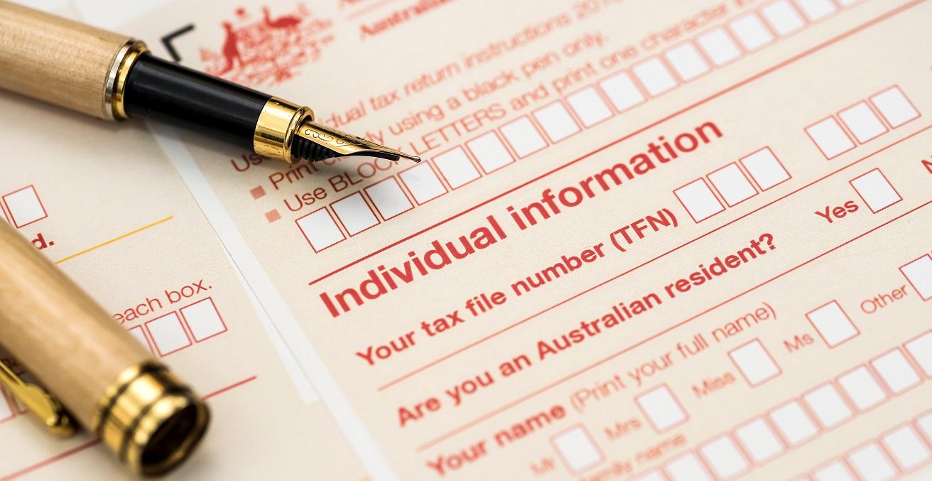 Australian annual tax form with pen. Source: RomanR/Shutterstock.