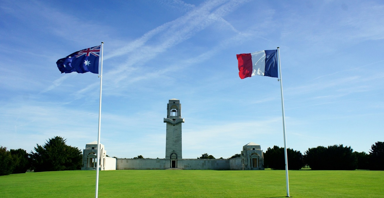 French and Australian flags fly at The Australian War Memorial in Villers Bretonneux. Source: James Robson 93 https://bit.ly/3uQpILz