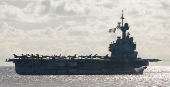 French Navy aircraft carrier, FS Charles de Gaulle (R 91) sails in formation during exercises La Perouse. The exercise, comprised of multiple anti-submarine warfare drills, was designed to enhance unit-level training, improve the strike group's ability to respond to a submarine threat, and enhance interoperability between the Quad and French navies. (U.S. Navy photo by Mass Communication Specialist 1st Class Leonard Adams)