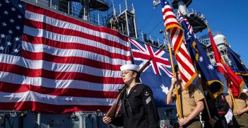 The color guard parades the colors during the closing ceremony of the eighth U.S. and Australian exercise Talisman Sabre 2019 held aboard the amphibious assault ship USS Wasp (LHD 1). Wasp Expeditionary Strike Group, with embarked 31st Marine Expeditionary Unit, just concluded exercise Talisman Sabre 2019 off the coast of Northern Australia. A bilateral, biennial event Talisman Sabre is designed to improve U.S. and Australian combat training, readiness and interoperability through realistic, relevant training necessary to maintain regional security, peace and stability. (U.S. Navy photo by Mass Communication Specialist Seaman Apprentice David Glotzbach)